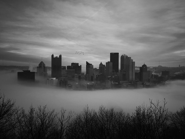 black and white photography city fog